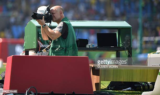 AFP Photographer Franck Fife is seen at work at the Olympic stadium of the Rio 2016 Olympic games on August 16 2016 in Rio de Janeiro An AFP team of...