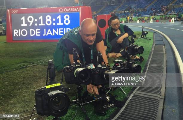 AFP Photographer Franck Fife prepares his remote controlled cameras before the final of the 100m Men's final at Rio 2016 Olympic games on August 14...