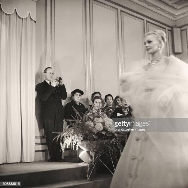 Photographer Franz Hubmann at a fashion show at WF Adlmueller Vienna 1958 Photograph by Barbara Pflaum