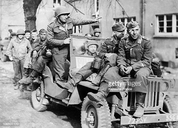 Photographer Fred Ramage transporting German Prisoners of War On His Jeep