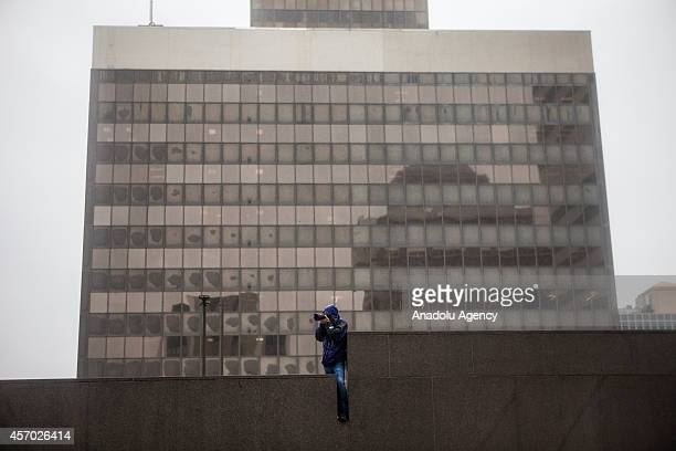 A photographer gains a higher vantage point of protestors gathering outside the District Prosecutors offices in Clayton Mo as part of the Ferguson...