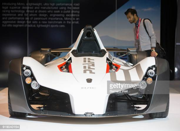 TORONTO ON FEBRUARY 15 A photographer gawks at a BAC Mono an ultralight high performance street legal super car at the Canadian International Auto...