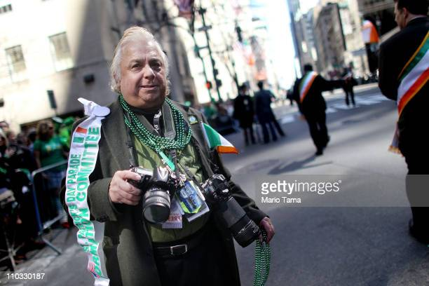 Photographer George Carva takes in the scene on Fifth Avenue at the 250th annual St Patrick's Day parade March 17 2011 in New York City The parade...