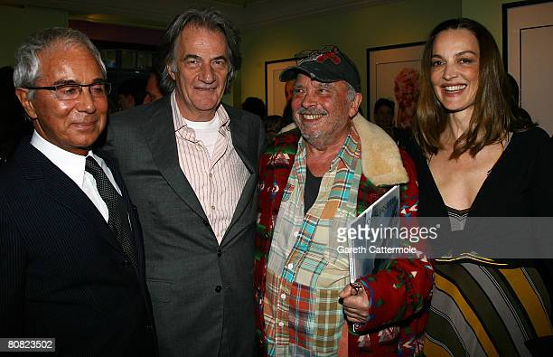 Photographer Gian Paolo Barbieri designer Paul Smith photographer David Bailey and his wife Catherine pose together at The Paul Smith store during...