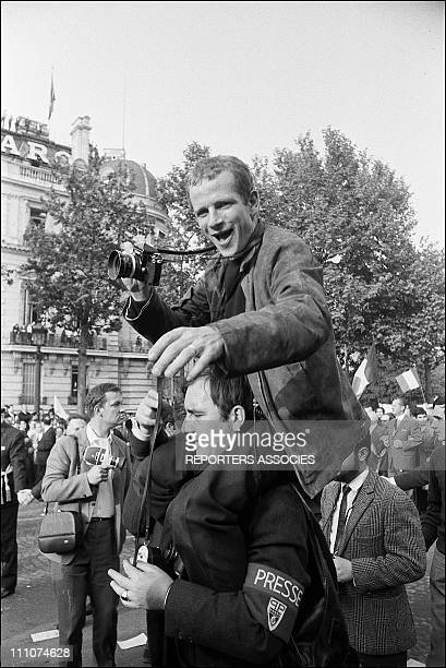 Photographer Gilles Caron at the Rally Gaullist on the Champs Elysees in Paris France on May 28th 1968