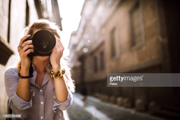 photographer girl in milan adventure - photographer stock pictures, royalty-free photos & images