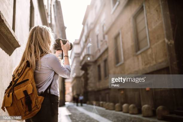 photographer girl in milan adventure - digital camera stock pictures, royalty-free photos & images