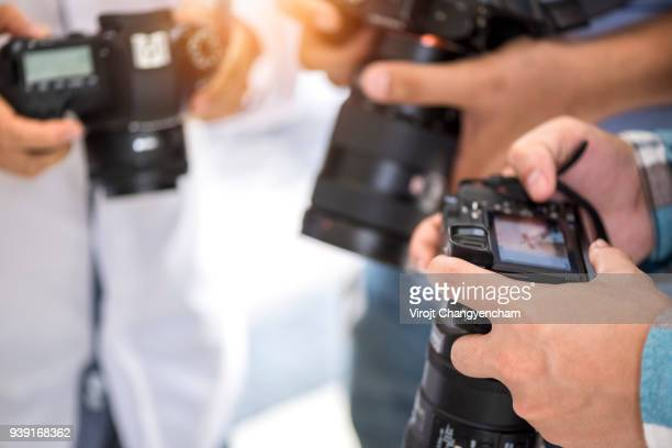 Photographer group look camera LCD live view checking work