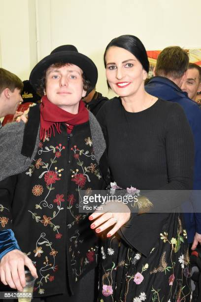Photographer Hannibal Volkoff and Sylvie Ortega Munos attend Lenedy Angot Calendar 2018 launch at Galerie Fabrice Hybert on December 1 2017 in Paris...