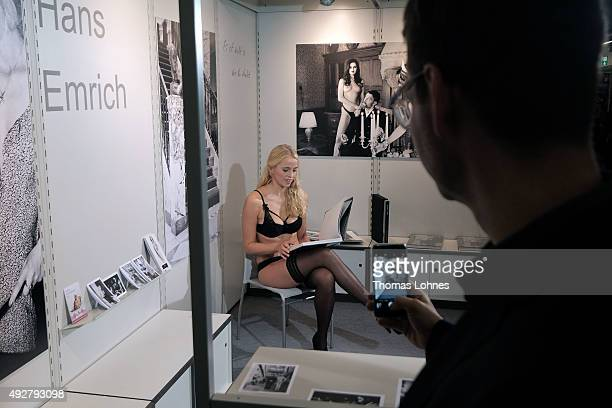 Photographer Hans Emrich pictures a model at the 2015 Frankfurt Book Fair on October 15 2015 in Frankfurt am Main Germany The 2015 fair which is...