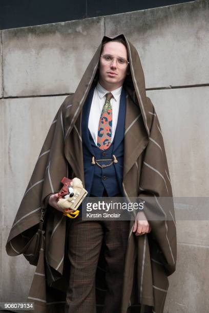 Photographer Harry Bartlett wears a Viviene Westwood chain, jacket, tie and cape, Calvin Klein shirt, vintage trousers and a Polaroid camera day 1 of...