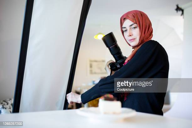 photographer having head covered with scarf. - photographer stock pictures, royalty-free photos & images