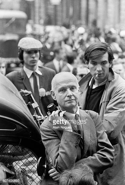 Photographer Henri CartierBresson stands by with his camera during the 1968 Paris riots In May of 1968 angry students and workers took to the streets...
