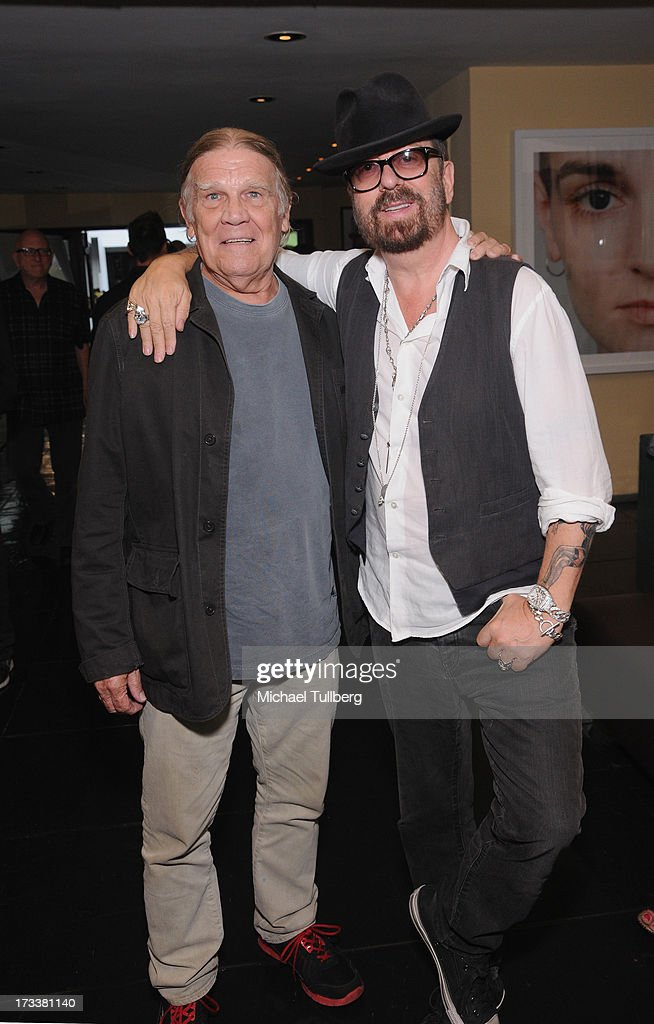 Photographer Henry Diltz and musician Dave Stewart attend the opening of Stewart's photography exhibition 'Dave Stewart: Jumpin' Jack Flash & The Suicide Blonde' at Morrison Hotel Gallery on July 12, 2013 in West Hollywood, California.