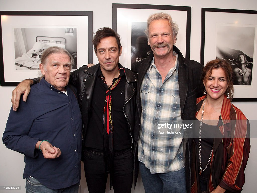Photographer Henry Diltz, musician Jamie Hince, gallery owner Peter Blachley and events director Suan Brandt attend the reception celebrating the book launch for 'Echo Home' by Jamie Hince of The Kills at Morrison Hotel Gallery on November 1, 2014 in West Hollywood, California.