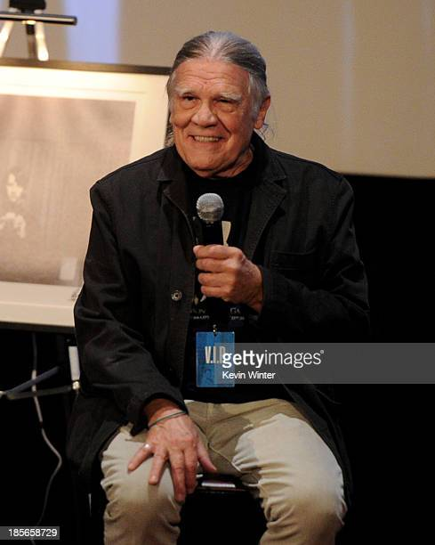 Photographer Henry Diltz speaks at Genesis Publications unveiling of PHOTOGRAPH by Ringo Starr at the Arclight Theatre on October 23 2013 in Los...
