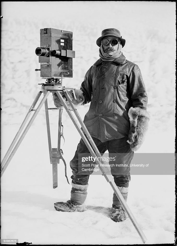 Photographer Herbert Ponting (1870 - 1935) stands with his cinematograph in the Ross Dependency of Antarctica, during Captain Robert Falcon Scott's Terra Nova Expedition to the Antarctic, January 1912.