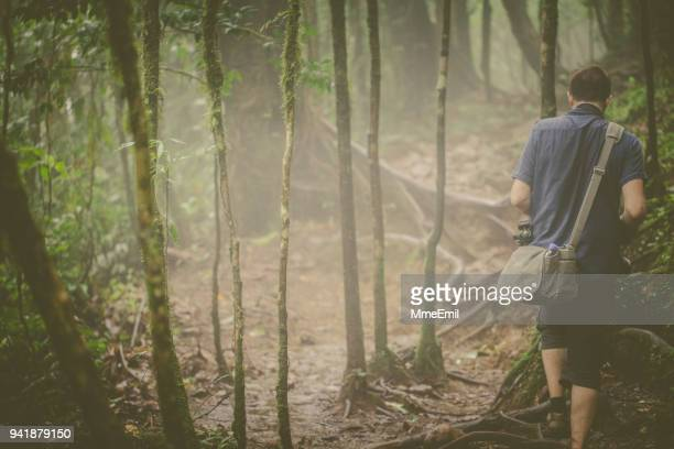 photographer hiking in wilderness area of costa rica - guanacaste stock pictures, royalty-free photos & images