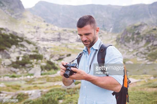 photographer hiking - martin dm stock pictures, royalty-free photos & images