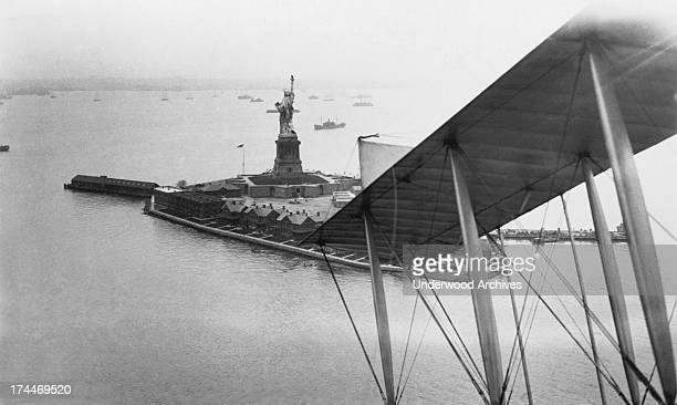 Photographer hitches a ride in a Navy seaplane to get this early aerial photograph of Bedloe's Island and the Statue of Liberty in NY harbor, New...