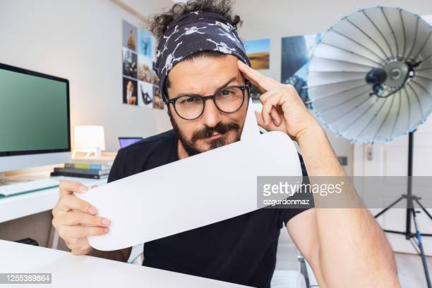 photographer holding a blank white board in the studio - istock images stock pictures, royalty-free photos & images