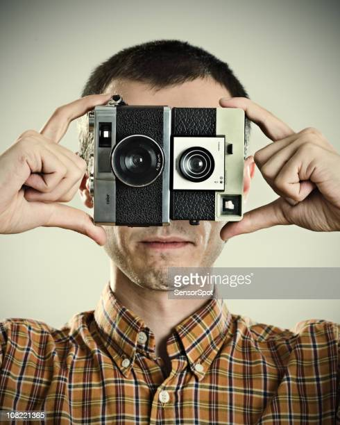 Photographer Holding Cameras to Eyes