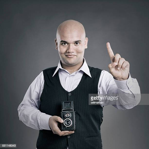 Photographer holding TLR camera