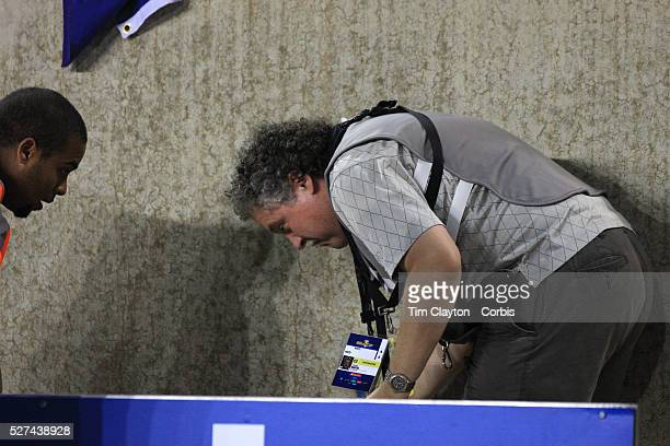 Photographer Howard Smith saves a squirrel after it appeared on the pitch during the Haiti V Honduras CONCACAF Gold Cup group B football match at Red...
