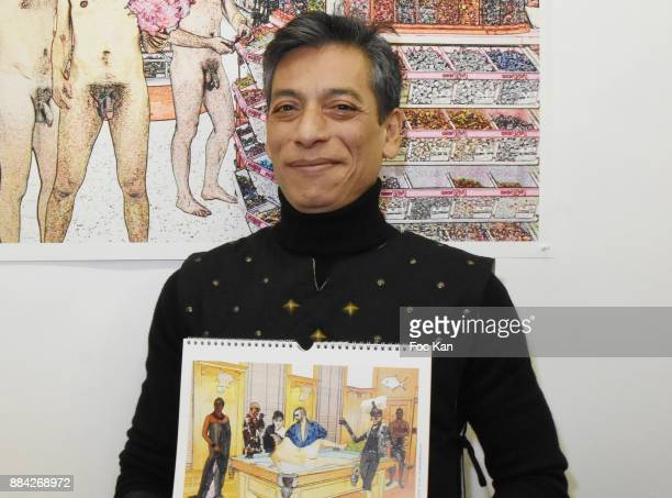 Photographer /illustrator Lenedy Angotposes with his work during Lenedy Angot Calendar 2018 launch at Galerie Fabrice Hybert on December 1 2017 in...