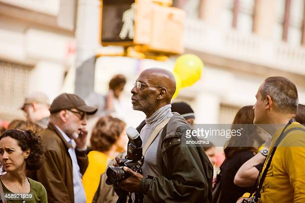 photographer in a crowd of protestors, new york - editorial stock pictures, royalty-free photos & images