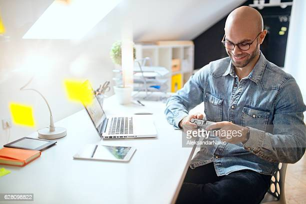 Photographer in his office