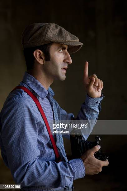 Photographer in old fashioned clothes holding medium format camera