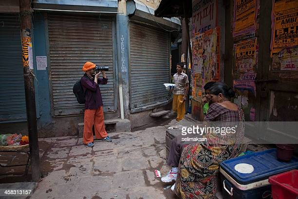 Photographer in old streets of Varanasi, India