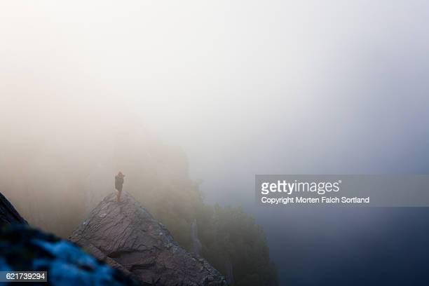 Photographer in the mis, Preikestolen, Norway