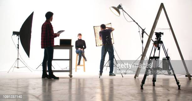 photographer in the studio - film studio stock pictures, royalty-free photos & images