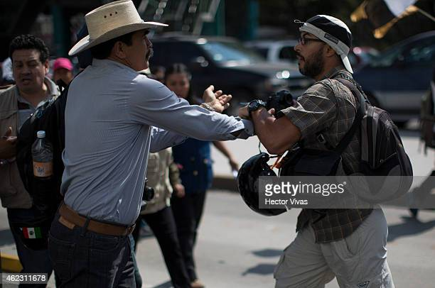 A photographer is attacked by protesters during a manifestation organized by demonstrators and relatives of the 43 missing students from Ayotzinapa...