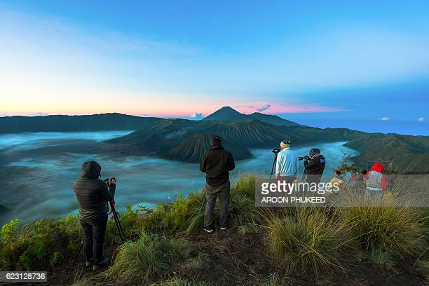 photographer is taking photo during sunrise - mt semeru stock pictures, royalty-free photos & images