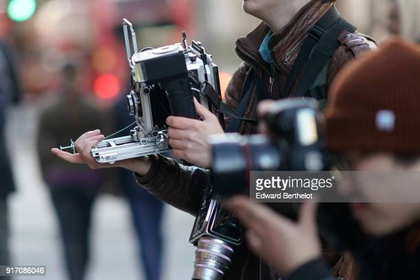 A photographer is using an old camera during London Fashion Week Men's January 2018 at on January 7 2018 in London England