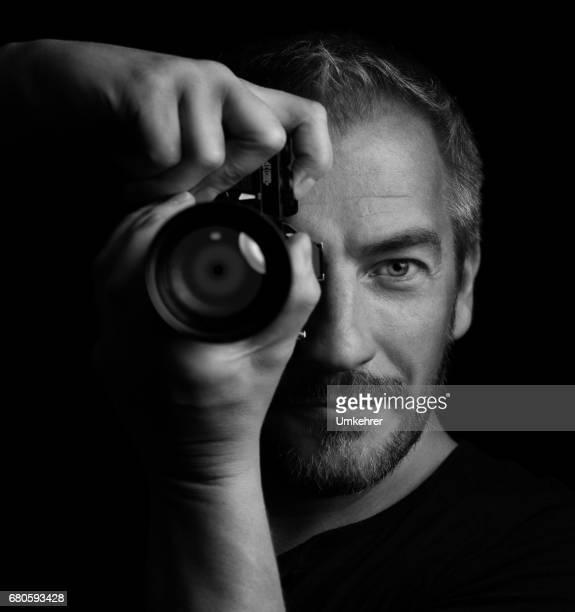 Fotograf, isoliert auf schwarz