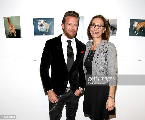 Photographer Jamie McCarthy and Executive Director Animal Care Control of NYC Risa Weinstock attends a pet portrait exhibition by Getty Images staff...