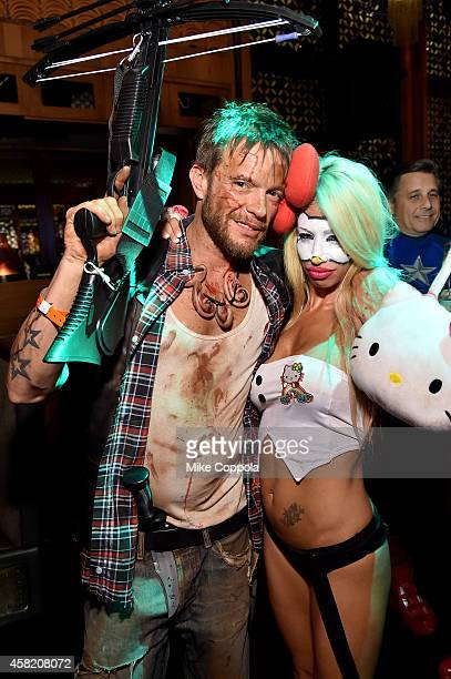 Photographer Jamie McCarthy and Lori Levine attend Moto X presents Heidi Klum's 15th Annual Halloween Party sponsored by SVEDKA Vodka at TAO Downtown...