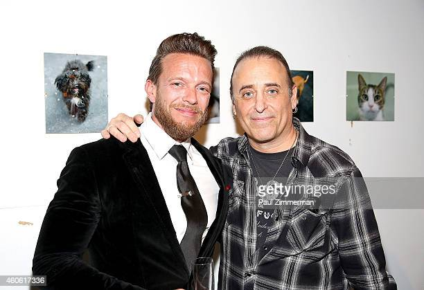 Photographer Jamie McCarthy and Mike Pont attend a pet portrait exhibition by Getty Images staff photographer Jamie McCarthy to benefit Animal Care...