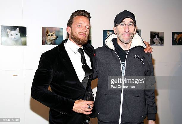 Photographer Jamie McCarthy and Richie Buxo attend a pet portrait exhibition by Getty Images staff photographer Jamie McCarthy to benefit Animal Care...