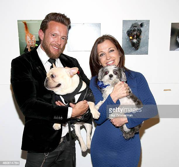 Photographer Jamie McCarthy and Wendy Diamond attend a pet portrait exhibition by Getty Images staff photographer Jamie McCarthy to benefit Animal...