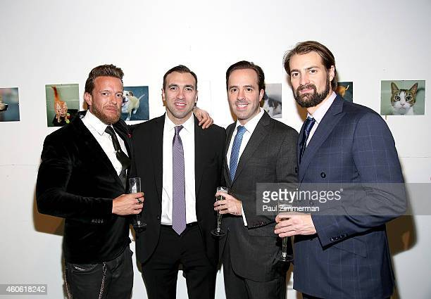 Photographer Jamie McCarthy Mike Moueaitis Basil C Sitaras and Alex Voetsch attend a pet portrait exhibition by Getty Images staff photographer Jamie...