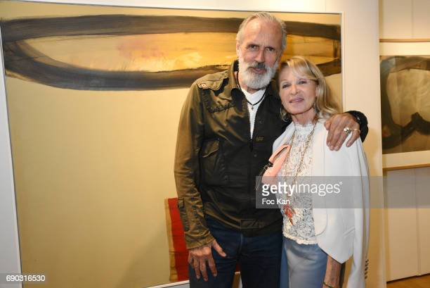 Photographer Jean Marie Marion and PR Ruth Obadia attend Ruben Alterio Paintings Exhibition Preview at Mairie du 1er Arrondissement on May 30 2017 in...