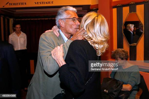 Photographer JeanMarie Perier and Nathalie Delon pose after the 'FlashBack' JeanMarie Perier's One Man Show at Theatre de la Michodiere on October 19...