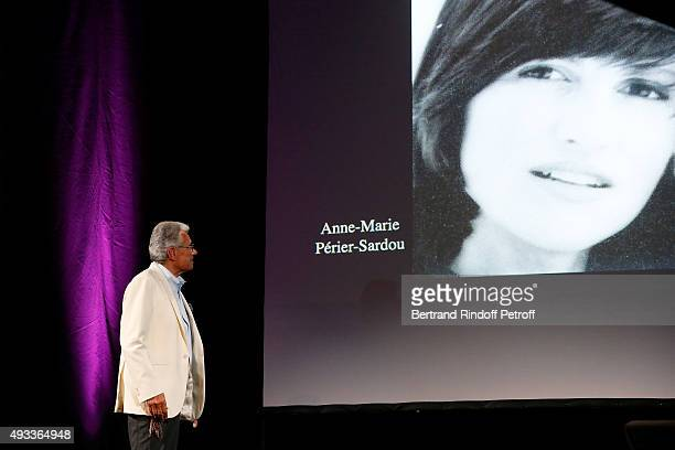 Photographer JeanMarie Perier performs in front of a pictures of his sister AnneMarie Perier Sardou during his 'FlashBack' One Man Show at Theatre de...