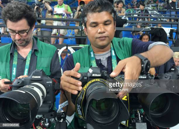 AFP Photographer Jewel Samad prepares his remote controlled cameras before the final of the 100m Men's final at Rio 2016 Olympic games on August 14...