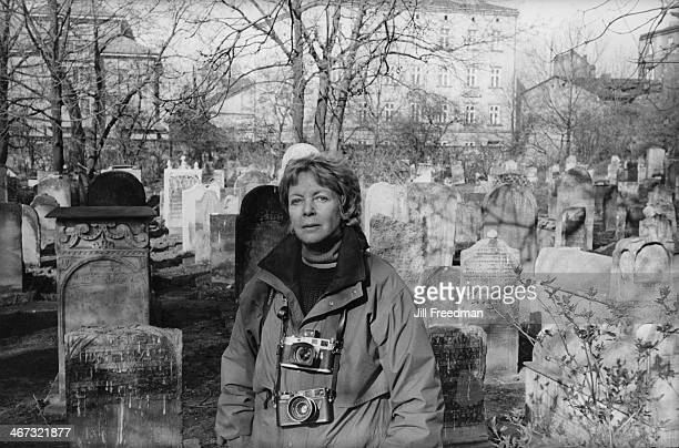 Photographer Jill Freedman in a Jewish cemetery in Poland circa 1993